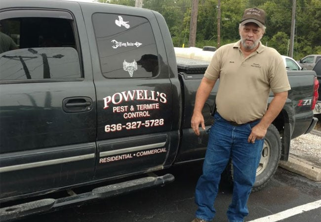 owner of Powell's Pest & Termite Control Inc. standing next to company truck